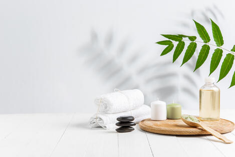 beautiful-spa-composition-on-massage-table-in-wellness-center-copyspace